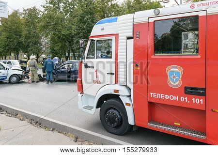 Orel, Russia - September 27, 2016: Firefighter car in place of collision between two cars. Rescuers work