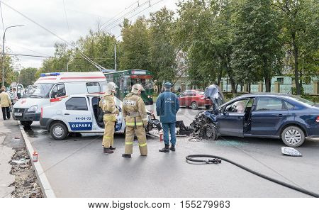 Orel, Russia - September 27, 2016: Rescue workers and ambulance car on place of traffic incident the collision of two cars