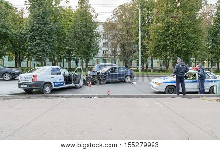 Orel, Russia - September 27, 2016: Police officers in a patrol car arrived at the scene of road accident (collision between two cars)