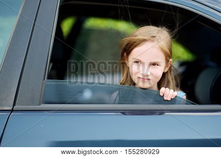 Little Girl Sticking Her Head Out The Car Window