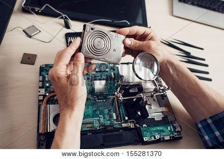 Winchester studying, engineer pov, repairman workplace with special tools. Electronic renovation, business, occupation concept