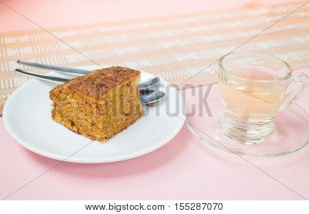 Hot tea and carrot cake stock photo