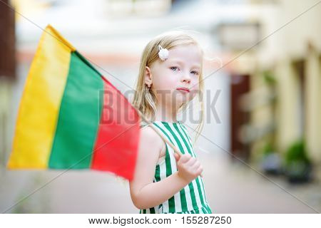 Cute Little Girl Holding Tricolor Lithuanian Flag