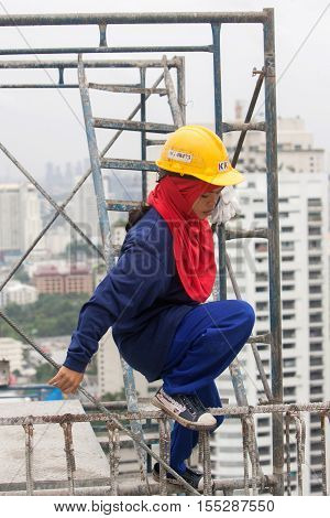 Bangkok, Thailand - November 10 2008 :  Bangkok, on top of a building under construction, women work for a low salary, the safety conditions are not always respected. Most workers come from the north east of Thailand, Cambodia and Myanmar.
