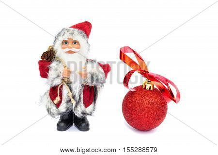 Father christmas figurine with bauble isolated on white background