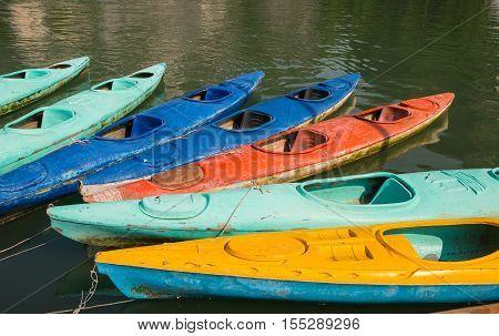 Kayaks for rent in Halong Bay, Vietnam, fiberglass kayaks, kayaking adventure, group of canoes or kayaks t pier