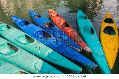 Kayaks for rent in Halong Bay, Vietnam, fiberglass kayaks, kayaking adventure, group of canoes or kayaks t pier