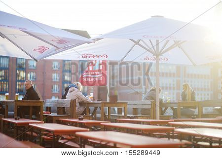 Bremen, Germany - March 23, 2016: Tourist Having A Beer In A Restaurant On An Embarktment Of Weser R