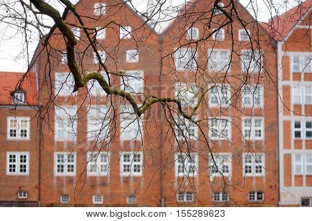 Historic Facades Of Houses On Embankment Of Weser River In Bremen, Germany