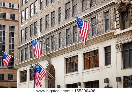 Flags Of The United States On A Skyscrapper In New York