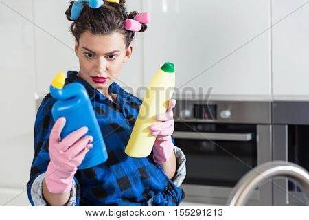 Woman Holding Two Bottles Of Cleaners