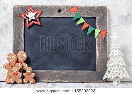 Christmas decoration with Happy Gingerbread man family and chalkboard