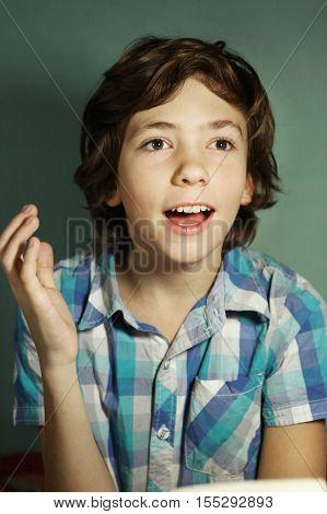 preteen handsome school boy happy expression find answer to difficult question