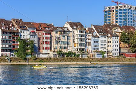 Basel, Switzerland - 27 August, 2016: buildings along the Rhine river. Basel is a city on the Rhine river in northwestern Switzerland, situated where the Swiss, German and French borders meet.