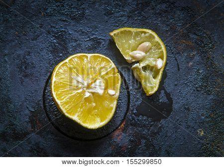Sluggish lemon on a black background.