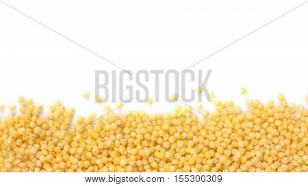 Background of millet with copy space. Isolated one edge. Top view or flat lay. Healthy food and diet concept