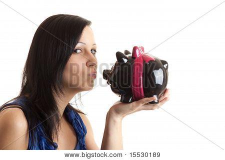 Young Woman Piggy Bank Kissing