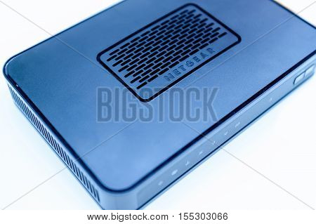 PARIS FRANCE - MAy 12 2015: Detail of Netgear ADSL modem used for adsl Asymmetric digital subscriber line or fiber optics line isolated on white background