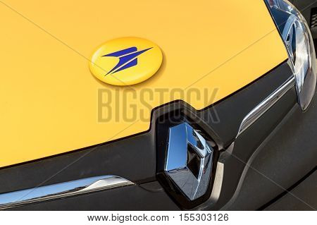 STRASBOURG FRANCE - JUN 24 2016: Renault delivery van of La Poste postal company in the morning delivering mail. La Poste is France's leading employer with a total workforce of 300000 working in postal shipping and banking branches