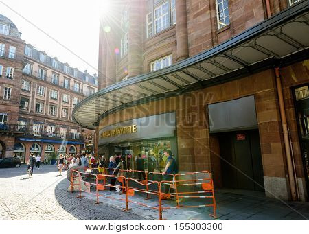 STRASBOURG FRANCE - JUN 24 2016: Shoppers waiting to enter the famous Galleries Lafayette in center of Strasbourg early in the morning during the start of the sale period