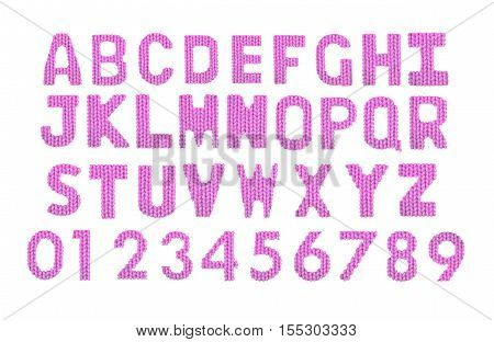 Letters and numerals english alphabet on a blurry texture knitted pattern of woolen thread closeup. Education and holidays. Typography design. Color pink