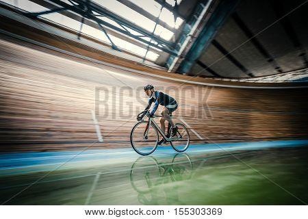 Active sportsman on a velodrome
