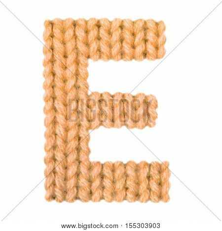 Letter E alphabet on a blurry texture knitted pattern of woolen thread closeup. One letter of the English alphabet. Education and holidays. Typography design. Color orange