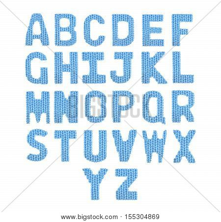 English alphabet on a blurry texture knitted pattern of woolen thread closeup. Education and holidays. Typography design. Color blue