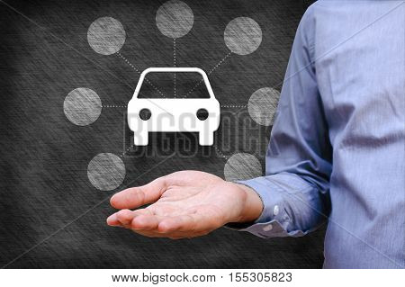 Car insurance and car services concept. Businessman holding icon of car and link copt space.