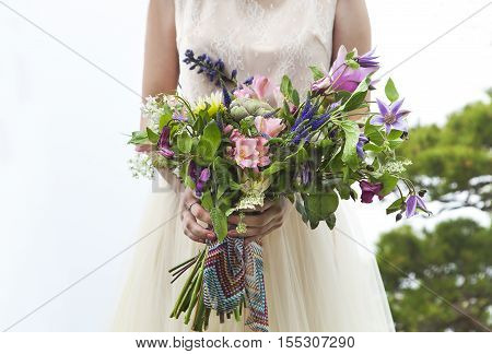 Beautiful bride outdoors in a mountain forest.