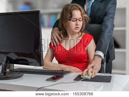 Harassment at workplace. Boss is seducing and flirting with secretary in office.