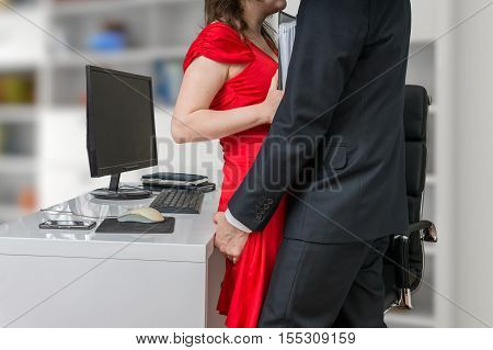 Love or harassment at workplace concept. Boss or manager is touching his secretary.