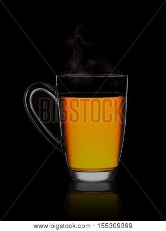 Hot flavored tea in a glass on a black background.