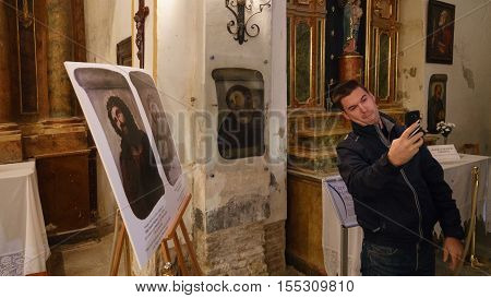 BORJA, SPAIN - NOVEMBER 5: An unidentified tourist takes photo in front of famous Ecce Homo Restoration on November 5, 2016 in Spain