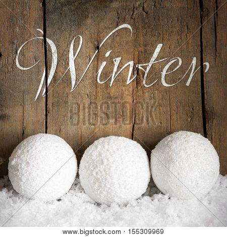 Three Snowballs With Wooden Background