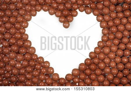 Chocolate ball background of milk chocolate ball sweets