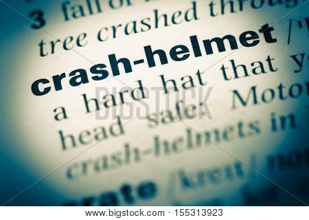 Close Up Of Old English Dictionary Page With Word Crash Helmet