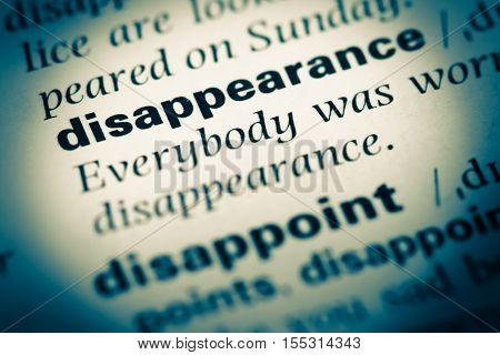 Close Up Of Old English Dictionary Page With Word Disappearance