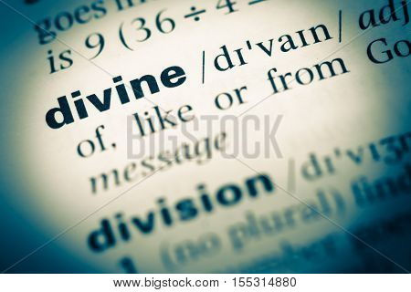 Close Up Of Old English Dictionary Page With Word Divine