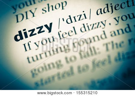Close Up Of Old English Dictionary Page With Word Dizzy