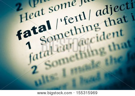 Close Up Of Old English Dictionary Page With Word Fatal