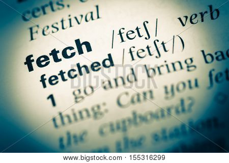 Close Up Of Old English Dictionary Page With Word Fetch