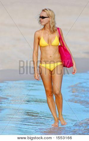 Lady In Yellow Bikini Strolling Along Beach