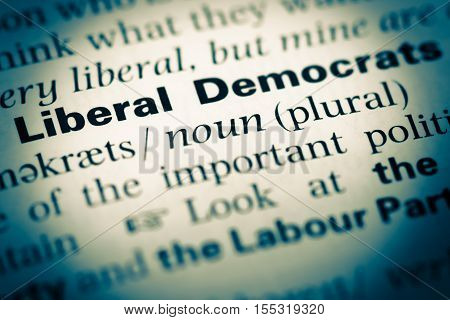Close Up Of Old English Dictionary Page With Word Liberal Democrats