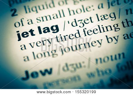 Close Up Of Old English Dictionary Page With Word Jet Lag