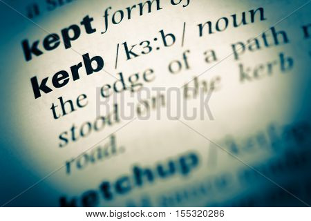 Close Up Of Old English Dictionary Page With Word Kerb