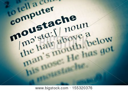 Close Up Of Old English Dictionary Page With Word Moustache