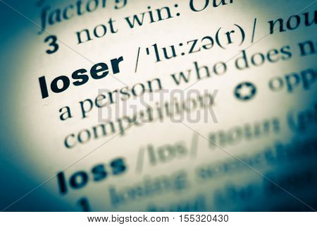 Close Up Of Old English Dictionary Page With Word Loser