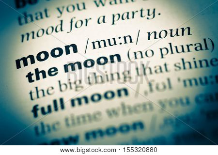 Close Up Of Old English Dictionary Page With Word Moon