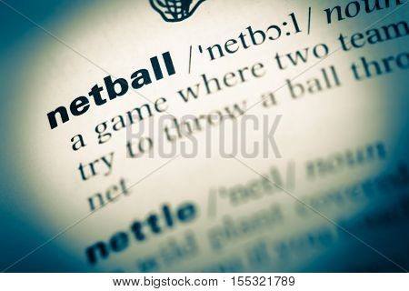 Close Up Of Old English Dictionary Page With Word Netball